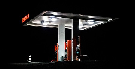 A texaco garage at night