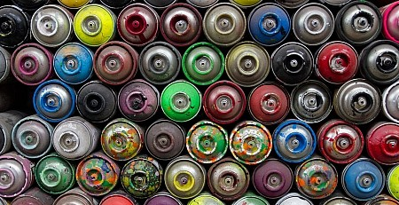 Birds eye view of spray paint cans grouped together