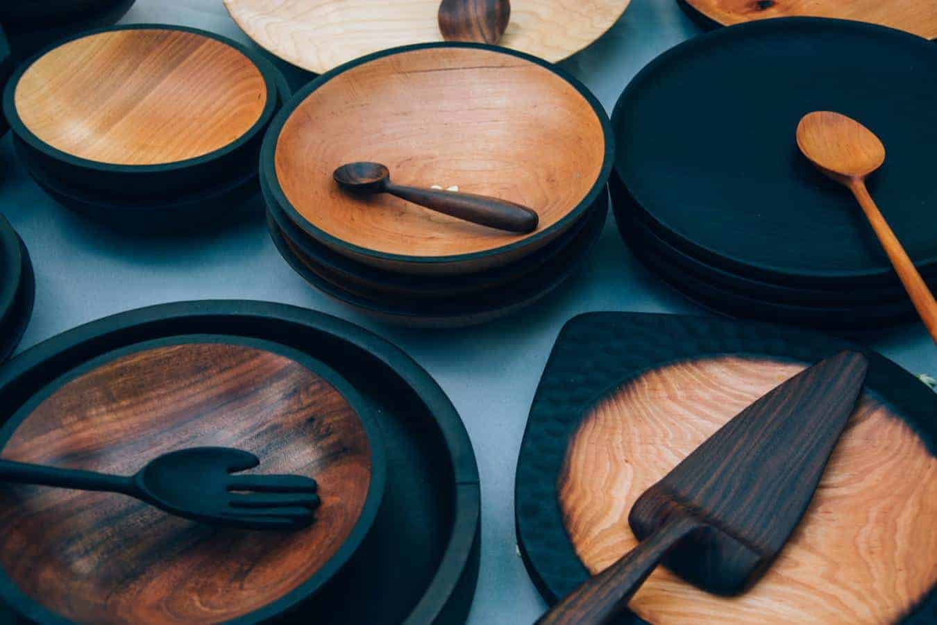 A set of wooden plates, bowls, and spoons