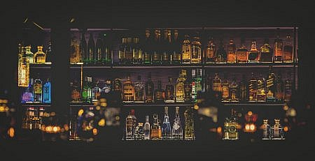 Bar shelves of liquor bottles