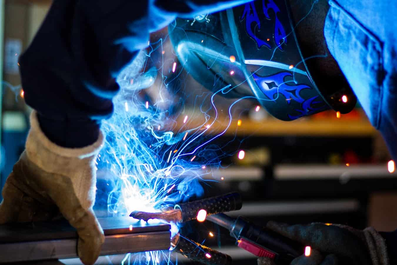 A close-up of a welder working on steel