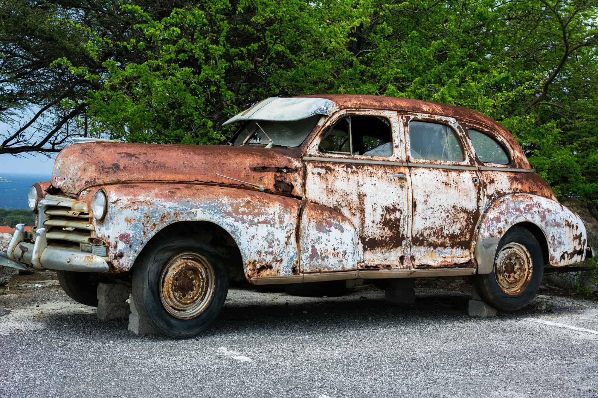 An old car covered in rust
