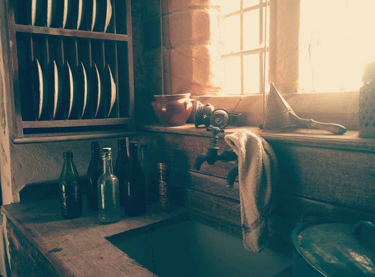 A rustic sink in a kitchen