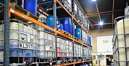 Rows of IBCs on factory pallet racking