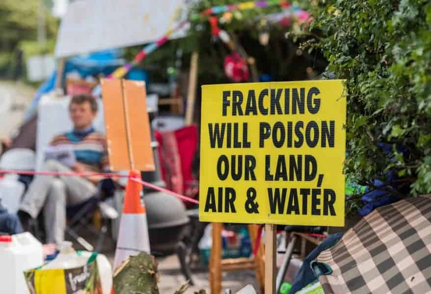 Fracking opponents protesting near fracking sites about the damage to health and the environment