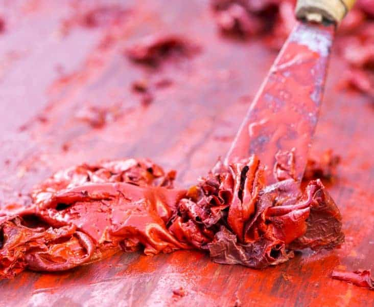 Red paint getting stripped from wood